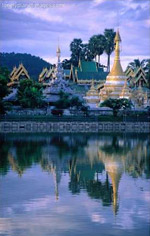 Wat Jong Kham Reflecting in Jong Kham Pond, Mae Hong Son, Thailand / Image by Joe Cummings